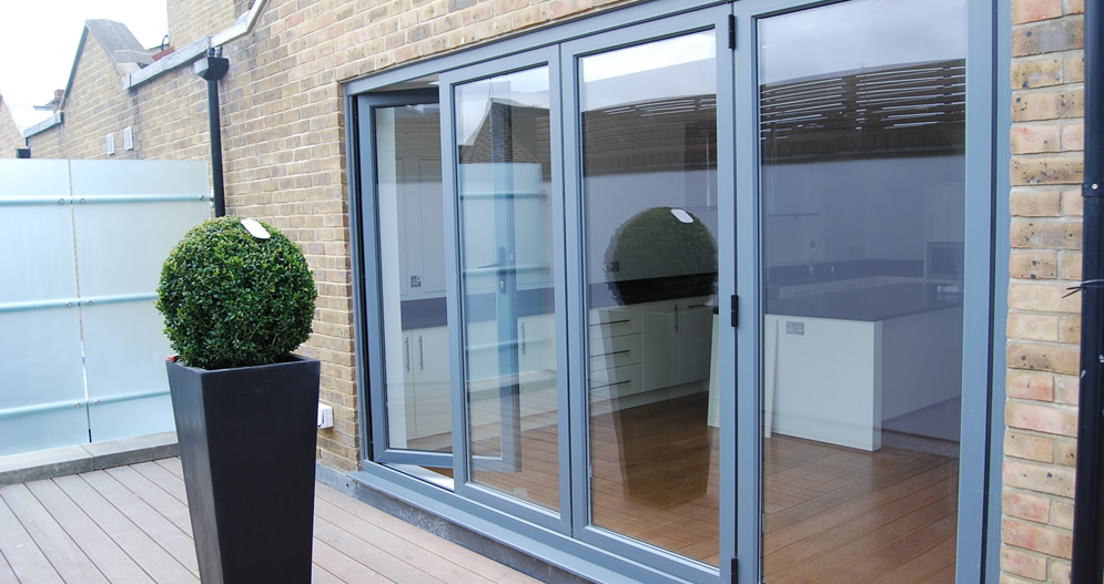 A  Part Bifold Door In Grey Gives This Dining Area A Light And Airy Appearance