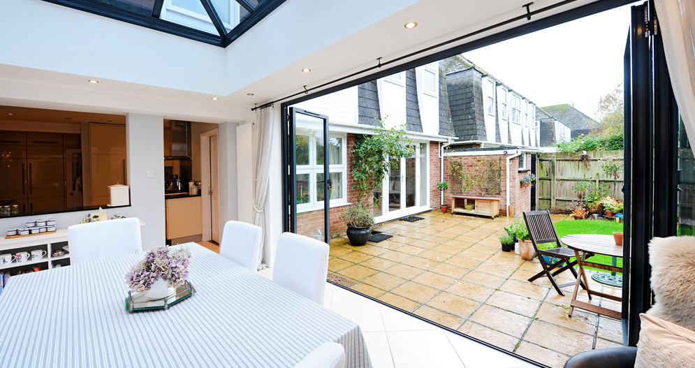 A 4 Part Bi Fold Door Bringing The Garden Into Dining Area
