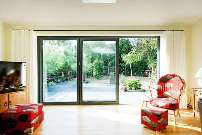 Bi fold doors living room south coast bi folds for Living room extensions