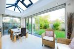Orangery system with Aluminium bi folding doors in Farrow and Ball French Grey
