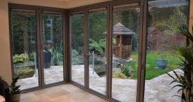 Bespoke corner bi folds has produced a stunning effect to this property